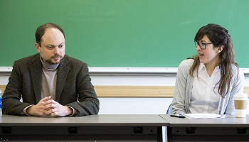 "Vladimir Kara-Murza, left, listens as Megan Turnbull, visiting assistant professor of political science, introduces him during her ""Democratic Erosion"" class."