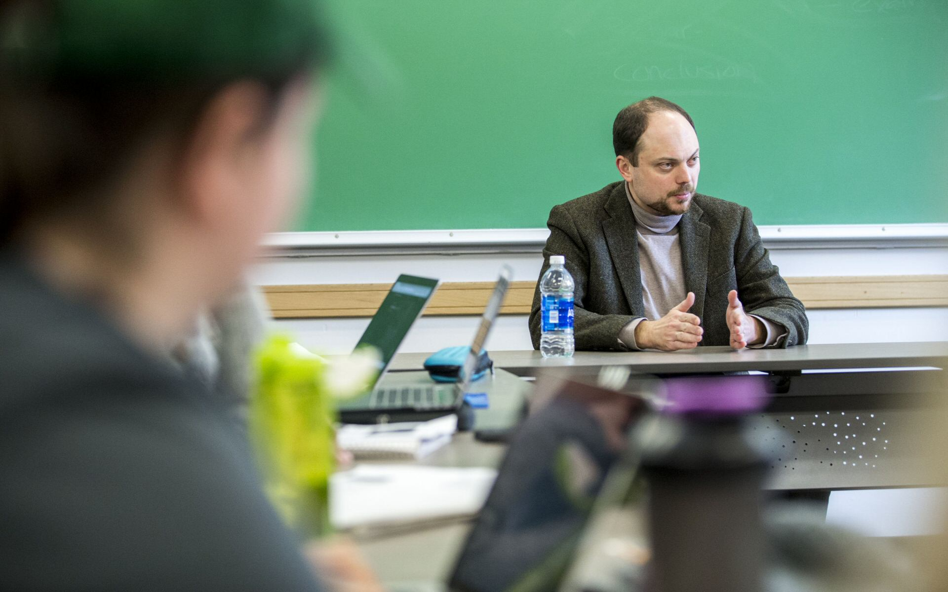 Russian documentarian-activitist talks to Skidmore students in a classroom