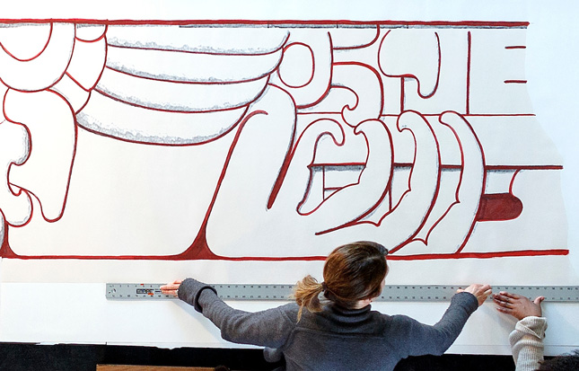 Heather Hurst measures out a closeup illustration from her Maya Temple art installation