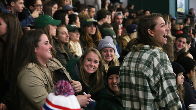 Skidmore student fans at a hockey game