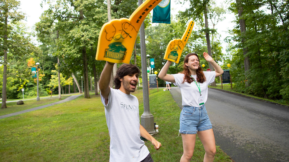 Students waving foam fingers at the entrance to Skidmore College