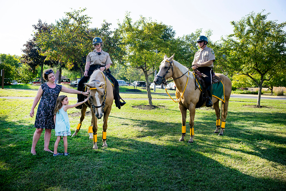 Skidmore College campus security officers and horses great visitors at Founder's Day Barbeque 2018