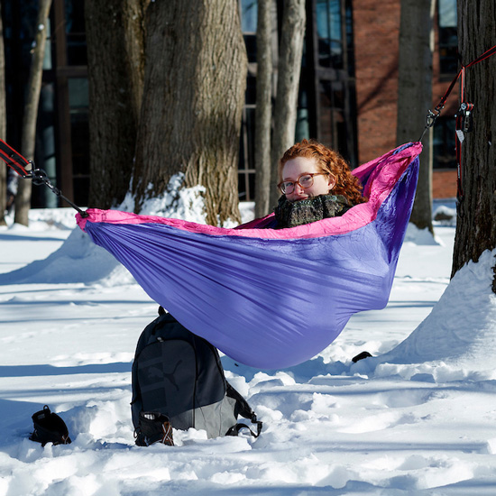 Skidmore+student+in+her+hammock+during+the+winter