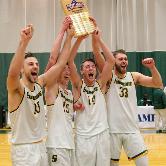 Skidmore+men%27s+basketball+players+celebrate+after+wining+the+2019+Liberty+League+championship+
