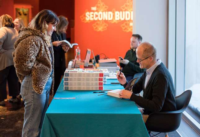 Chris Ware signs books before the Winter/Miller Lecture