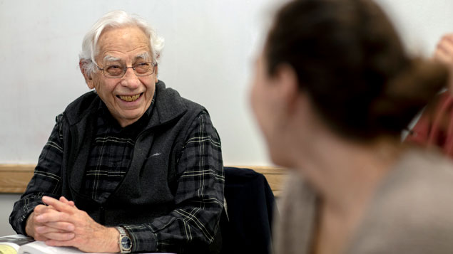 Lewis Taub sits in classroom