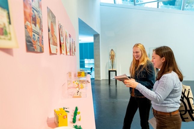 college students examine art at the tang teaching museum