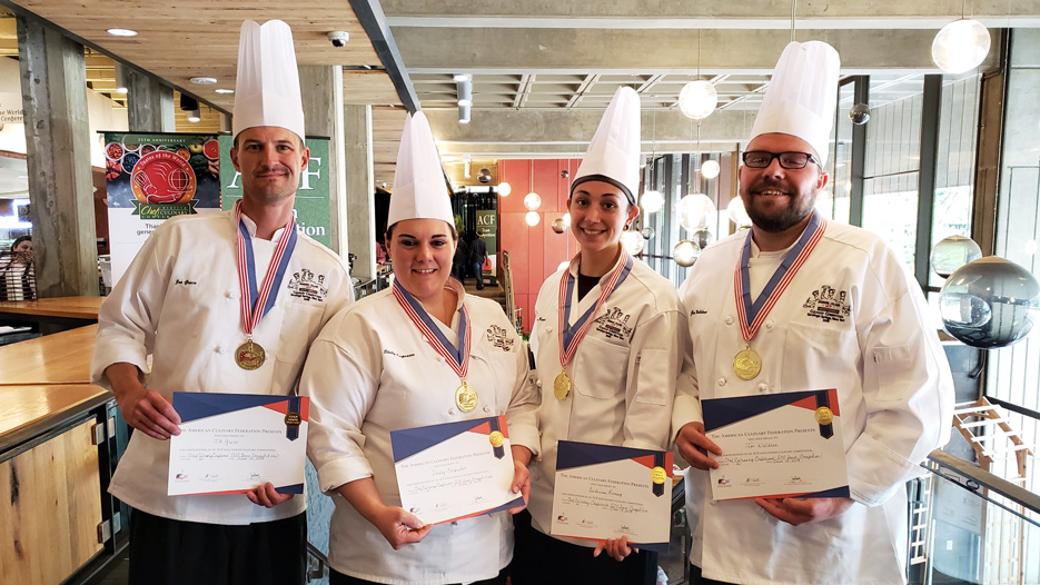 Members of Skidmore's dining services team pose with their awards after a culinary competition