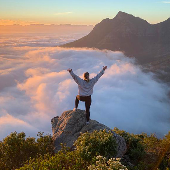 A+student+studying+abroad+in+South+Africa+has+her+photo+taken+overlooking+a+mountain+range