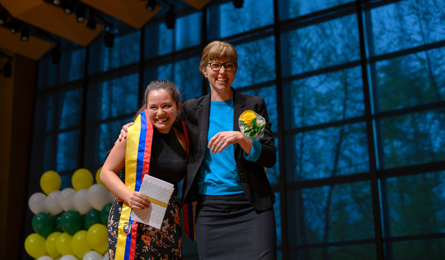 Cinthia Duran Larrea '19, and her mentor Katherine Paarlberg-kvam embrace during Skidmore's Stoles and Cords Recognition Ceremony at Zankel Music Center.