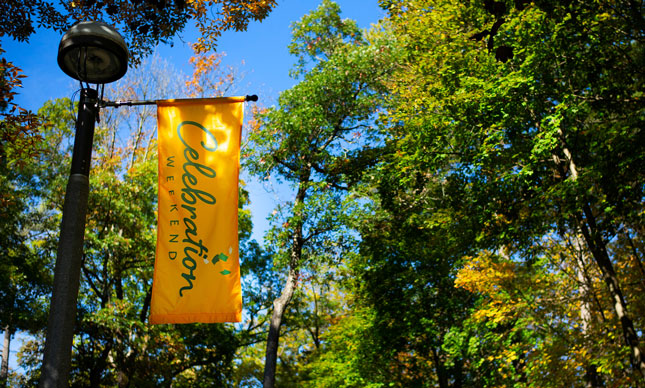 "A banner that says ""Celebration Weekend"" hangs over Skidmore College campus"