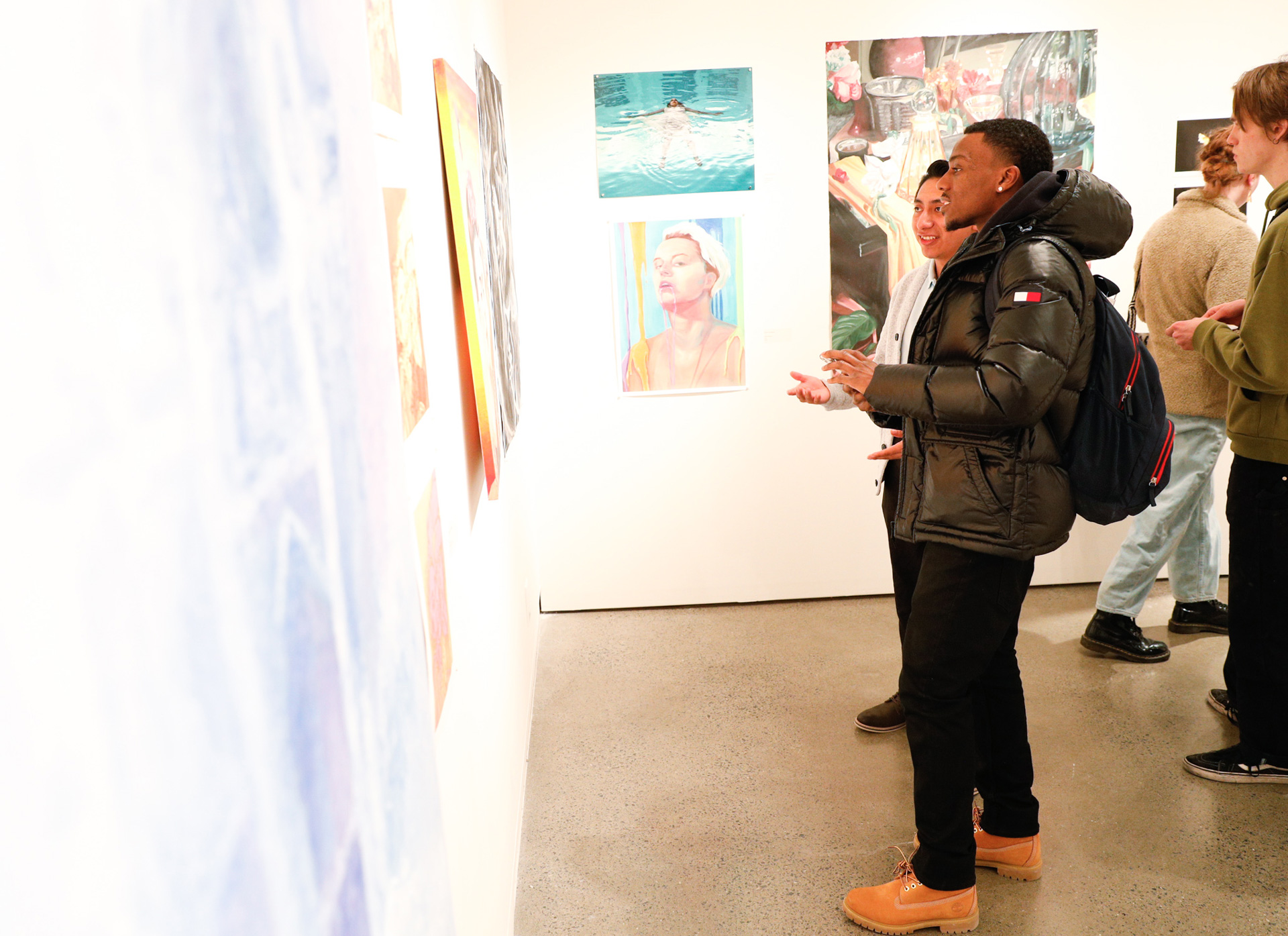Maurice Thompson '22 looks at art during the 2020 Juried Skidmore Student Exhibition at the Schick Art Gallery