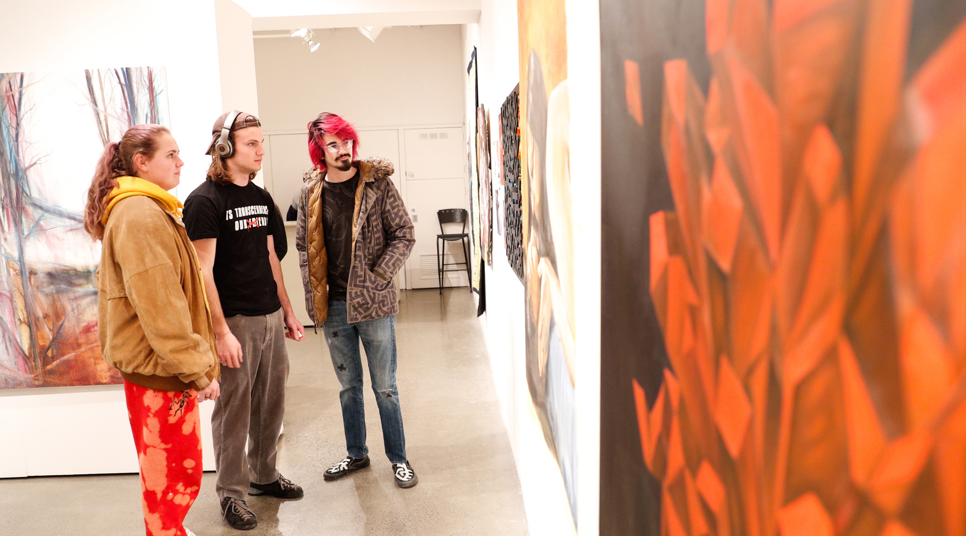 Skidmore students view artwork during the 2020 juried Skidmore student exhibition at the Schick Art Gallery