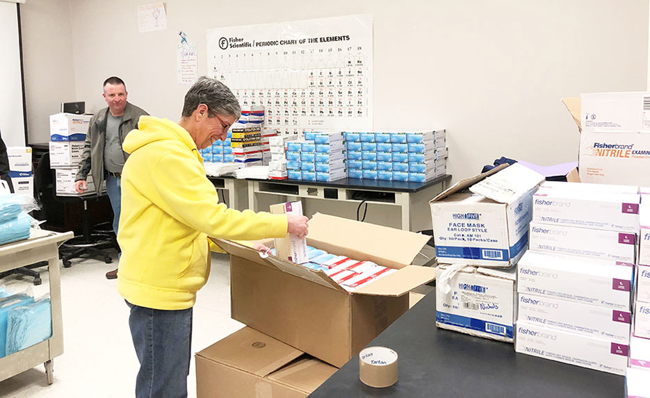 Skidmore Health Services Director Patricia Bosen and Campus Safety Director Timothy Munro, left, prepare donations for Saratoga Hospital.