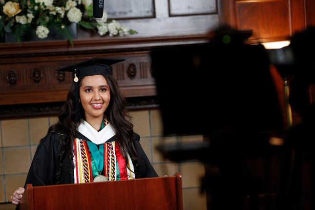 Jinan Al-Busaidi '20, class president, speaks to classmates during the live streamed virtual ceremony