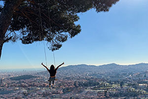 Beatrize on a tree swing overlooking Barcelona, Spain