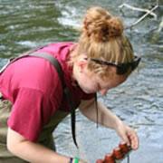 Claire Superak '11 sampling water