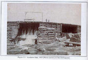 Historical photo of a log dam
