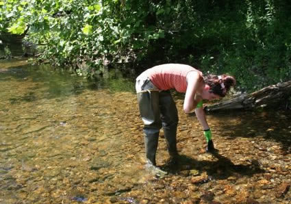 Emily Stulik '10 sampling water