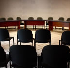 Empty chairs at a planning meeting